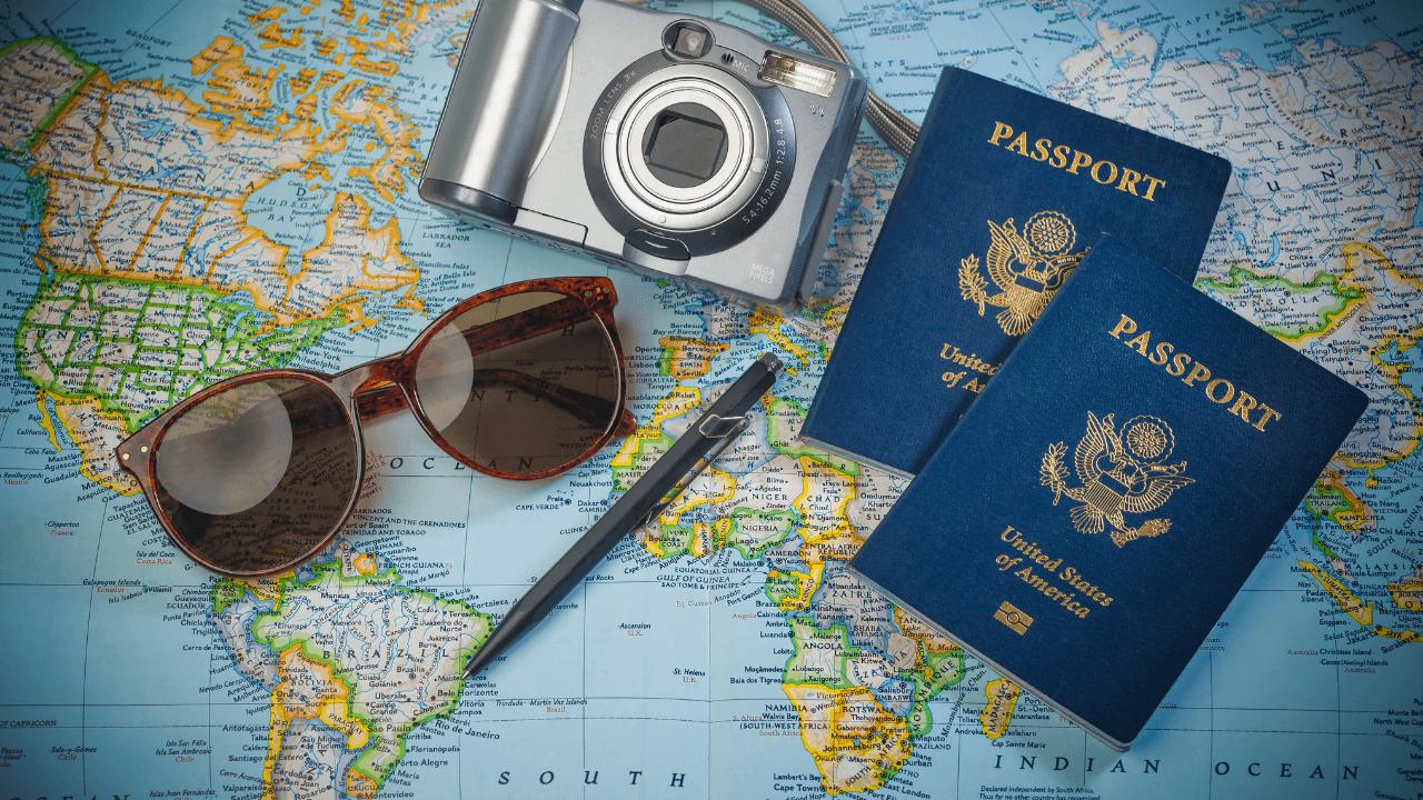 Passport, sunglasses, camera, travel