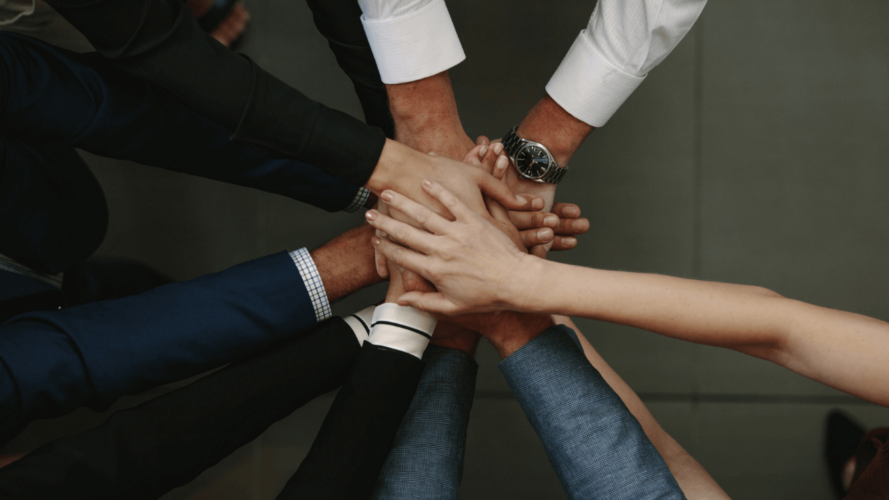 Multicultural hands in a pile - teamwork