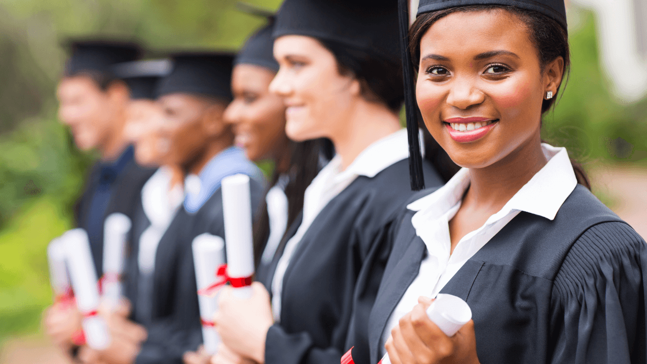 University graduates holding degree