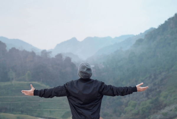 man celebrating a beautiful view