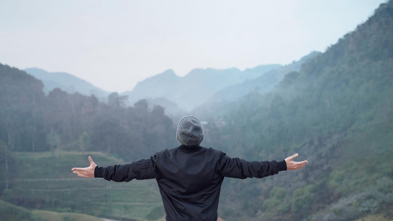 man celebrating a beautiful view