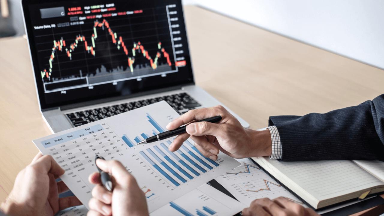 Investors looking at charts