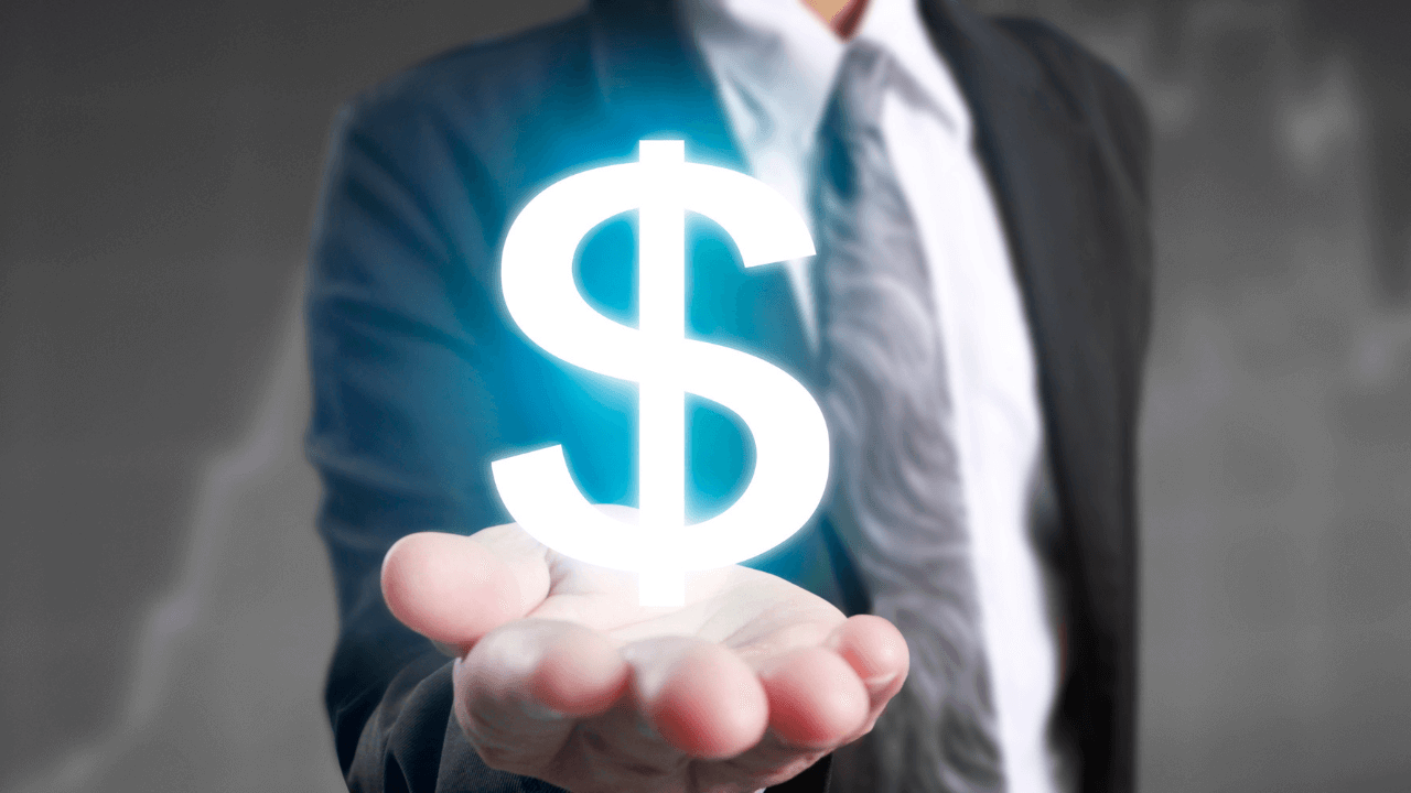 Man holding a money symbol in his hand