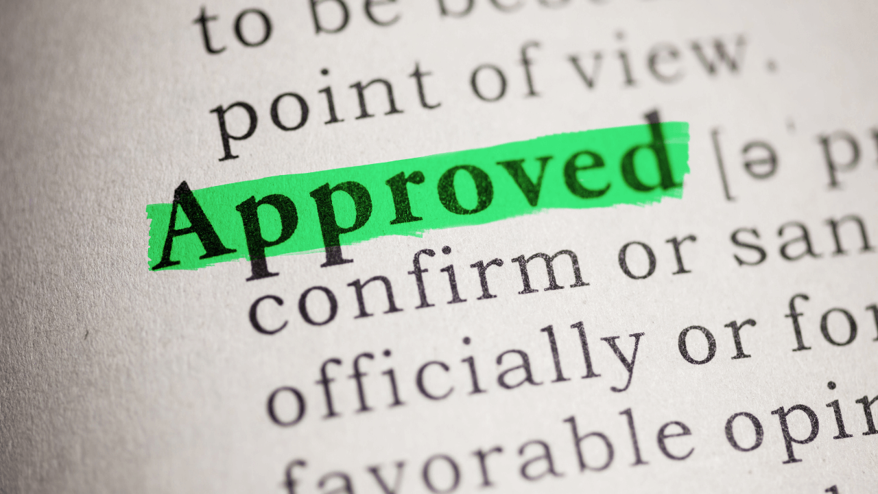 Approved highlighted in green on a paper