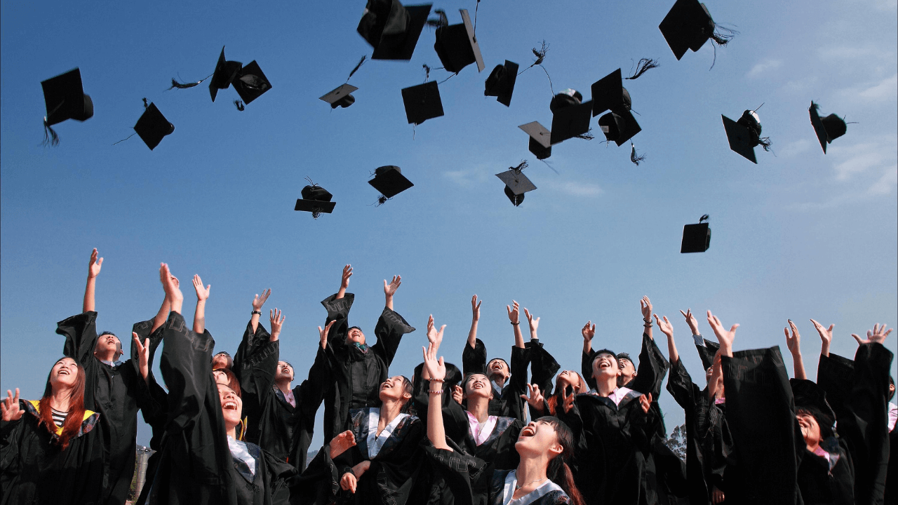 Students throwing their caps at graduation