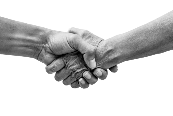 two hands meeting in the middle