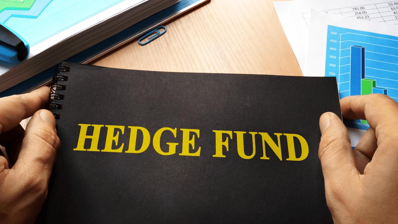 Man holding hedge fund binder