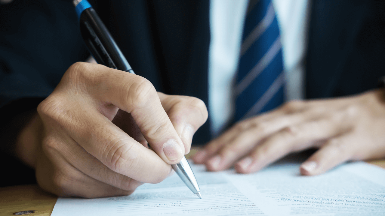 Business man writing document