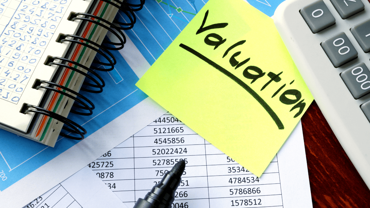 Charts, numbers, and valuation on a post it note
