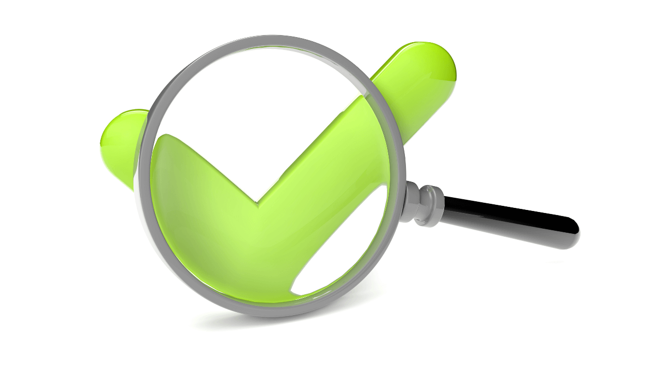 A green check mark and magnifying glass